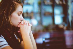 A woman praying the Jesus Prayer