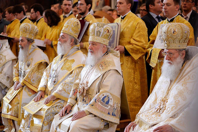 Orthodox clergymen in their liturgical vestments.