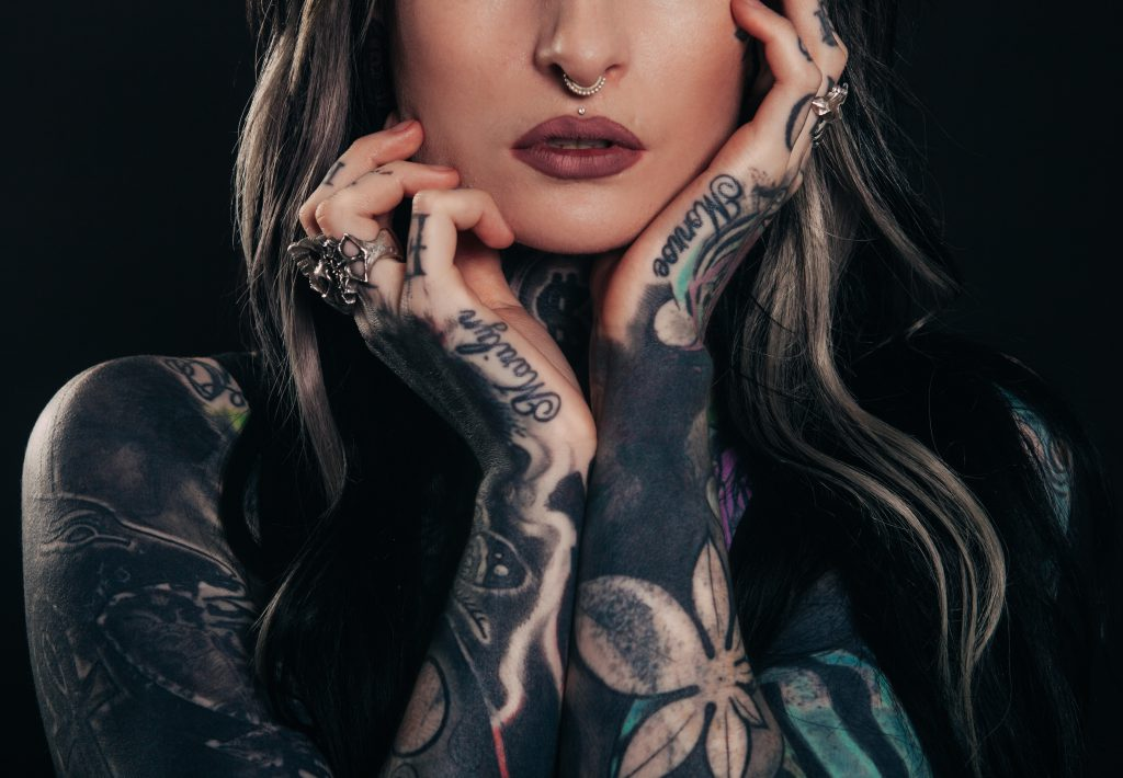 woman with tattoos on her arms