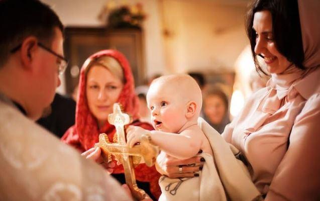 Godparent holding godchild