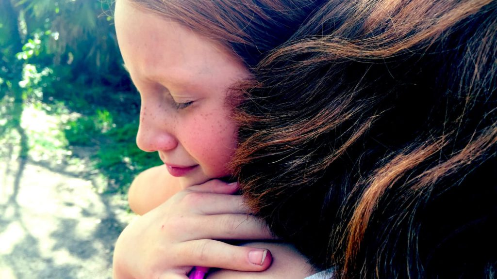 Young girls forgiving each other